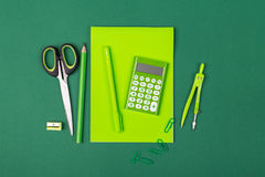 School stationery. School office stationery on green background Stock Photo