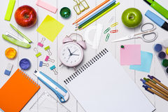 School stationery or office supplies on wood background. Royalty Free Stock Photo