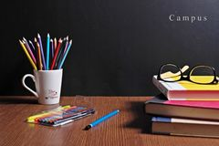 Back to school. School Stationery  are on the table infront of a black board Stock Images