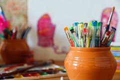 School stationery on a colored background. School stationery on a watercolor background, in a clay pot Royalty Free Stock Photography