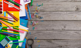 School stationery on the wooden table with copy space. Top view Stock Photo