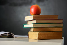 School still life with books and blackboard Stock Image