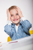 School stress. Boy with a sketch-pad at a table in a stress situation stock photo