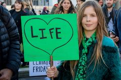 School Strike for Climate Change. London, UK, United Kingdom 15th February 2019:- Striking school aged children in central London over climate change holding a royalty free stock photos