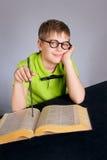 School student. Reading a book stock photos