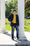 The school student in a jacket and a yellow shirt at colons Royalty Free Stock Photography