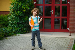 The school student rejoices to the termination of academic year . Royalty Free Stock Photography