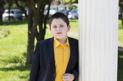 The school student`s portrait in a yellow shirt at colons Stock Photo