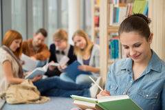 School student studying in library Stock Photo