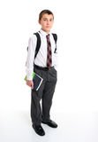 School student in white shirt and greay trousers. A high school student wearing a white shirt, tie and greay trousers.  He is carrying a backpack on his Royalty Free Stock Images
