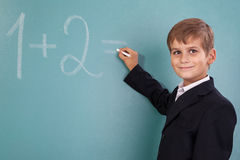 School student writing on blackboard at school Royalty Free Stock Photos