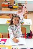 At school, the students sit in the pew: Portrait.  Royalty Free Stock Photos