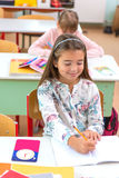 At school, the students sit in the pew: Portrait Royalty Free Stock Image