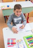 At school, the students sit in the pew: Portrait Royalty Free Stock Photography