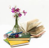 School subjects and flowers in a vase. Stock Photo