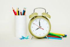 School suplies. colored Crayons. Green Clock Isoalted on White Background. School suplies. colored Crayons. Green Clock Isoalted on White royalty free stock photography