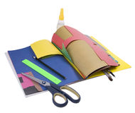 School supplies. Scissors glue compasses tassel pencil straightedge on colored paper on white Royalty Free Stock Photography