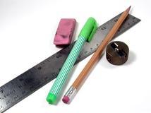 School Supplies. Still life of school supplies: ruler, pencil, sharpener,eraser, and highlighter Stock Photos