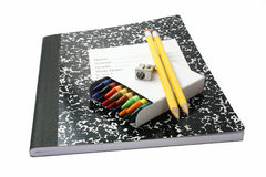 School Supplies. Crayons, pencils, notebook and pencil sharpener Royalty Free Stock Photos