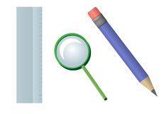 School supplies. Ruler, hand glass and a pencil Royalty Free Stock Images