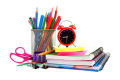 School supplies with alarm clock over white. Collection of colorful school supplies with alarm clock over a white background Royalty Free Stock Images