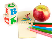 School supplies and apple