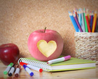 School supplies and  apple. Stock Image