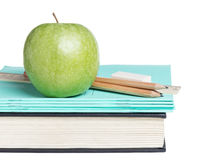 School supplies with apple on book Royalty Free Stock Photos