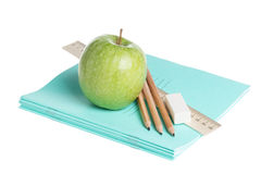School supplies with apple Royalty Free Stock Images