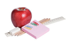 School supplies with apple Stock Photography