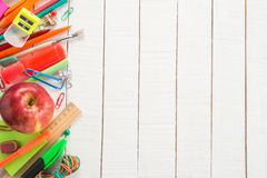 School supplies and apple. On wooden background Stock Image