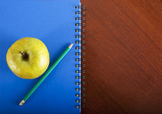 School supplies apple on wooden table, back to school concept Royalty Free Stock Photos