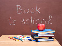 School supplies and apples Stock Images