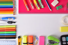 School supplies around white table Stock Images