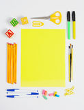 School Supplies Around Yellow Paper Royalty Free Stock Photos