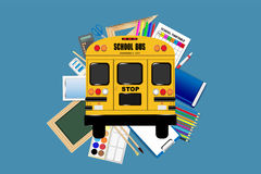 School supplies around  the yellow school bus Royalty Free Stock Images