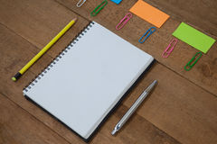School supplies arranged on wooden table Royalty Free Stock Image