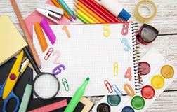 School supplies. Assorted school supplies with a notebooks, pencils, pens, scissors etc Stock Photos