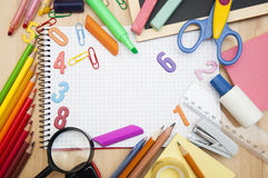 School supplies. Assorted school supplies with a notebooks, pencils, pens, scissors etc Stock Photo