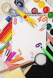 School supplies. Assorted school supplies with a notebooks, pencils, pens, scissors etc Royalty Free Stock Images