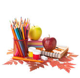 School supplies and autumn leaves. Stock Photos