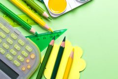 School supplies. Back to school concept on green background Top view Flat lay. Mockup stock images