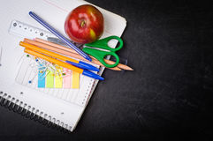 School supplies on the background of blackboard Royalty Free Stock Photo