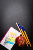School supplies on the background of blackboard Stock Photos