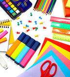 School supplies background. Colorful paper, markers, pencils and other different stuff on the desk, education and art in the school Royalty Free Stock Photography