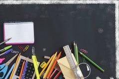 School supplies. On balckboard, back to school Stock Images