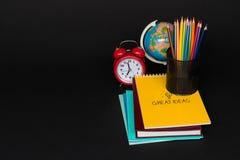 School supplies on black background stock image