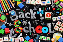 School supplies on black schoolboard background Stock Photography