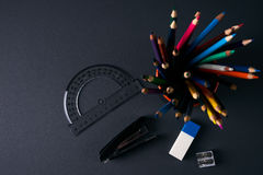 School supplies. On black table. Close up.Top view.Copy space Stock Image