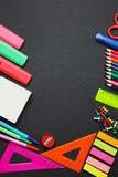 School supplies on blackboard Royalty Free Stock Images
